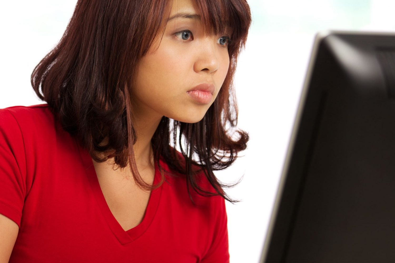 10348980 - image of a female working at desk