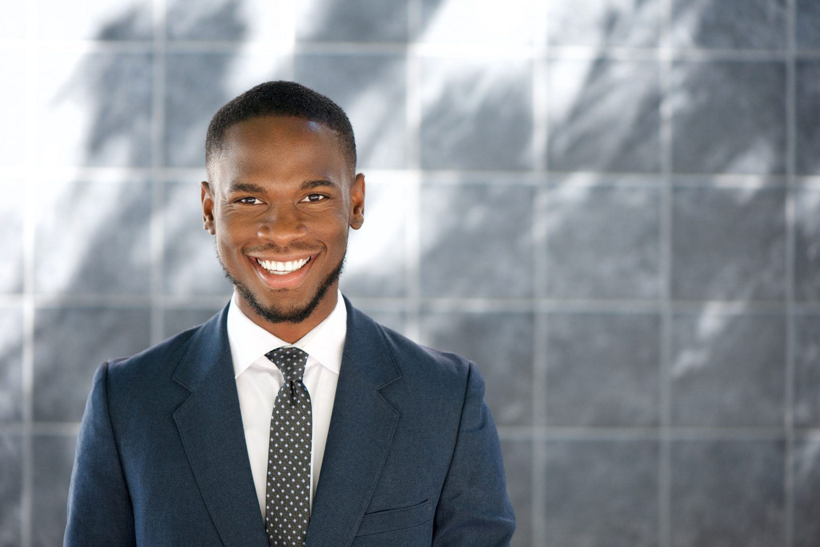 36346868 - close up portrait of a friendly young businessman smiling