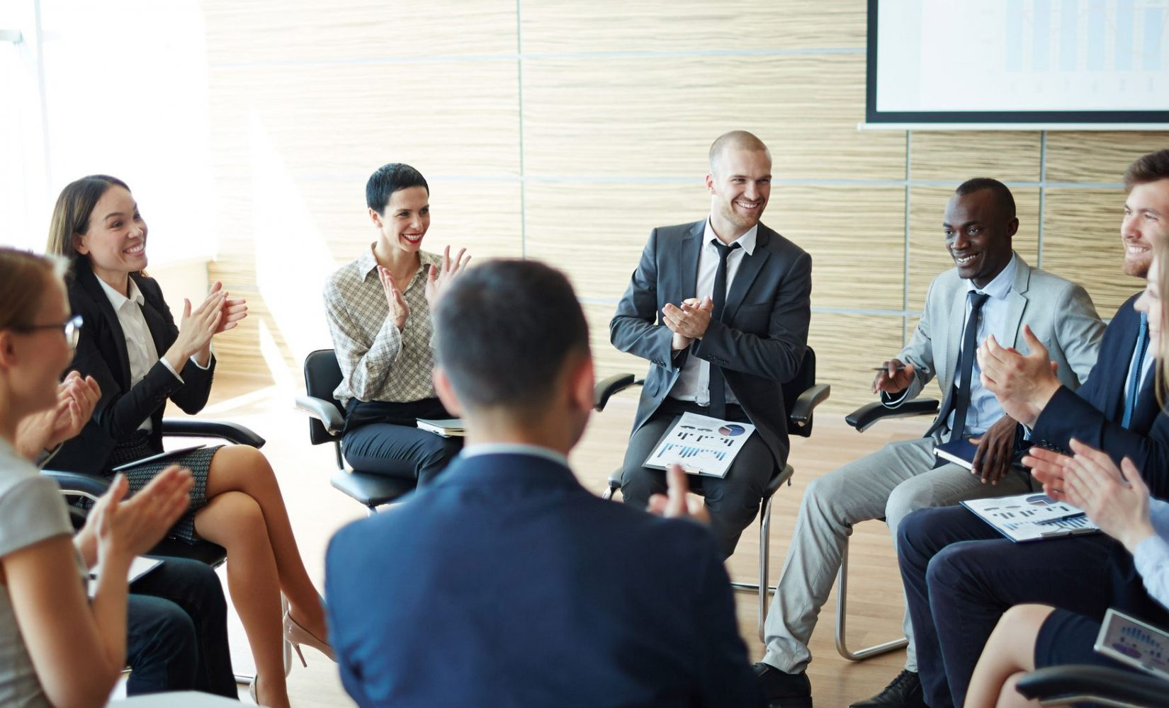 59971520 - business team applauding at a meeting