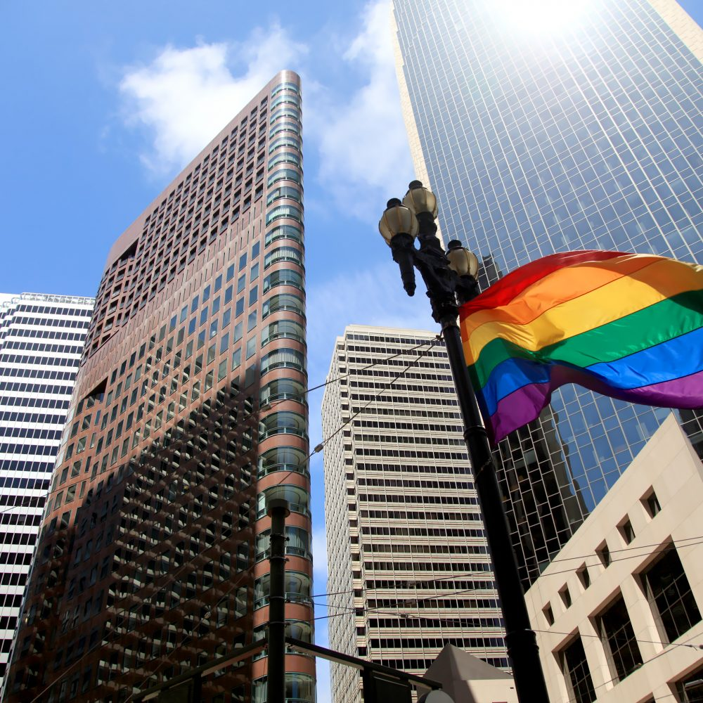 Gay pride flag against modern background in San Francisco