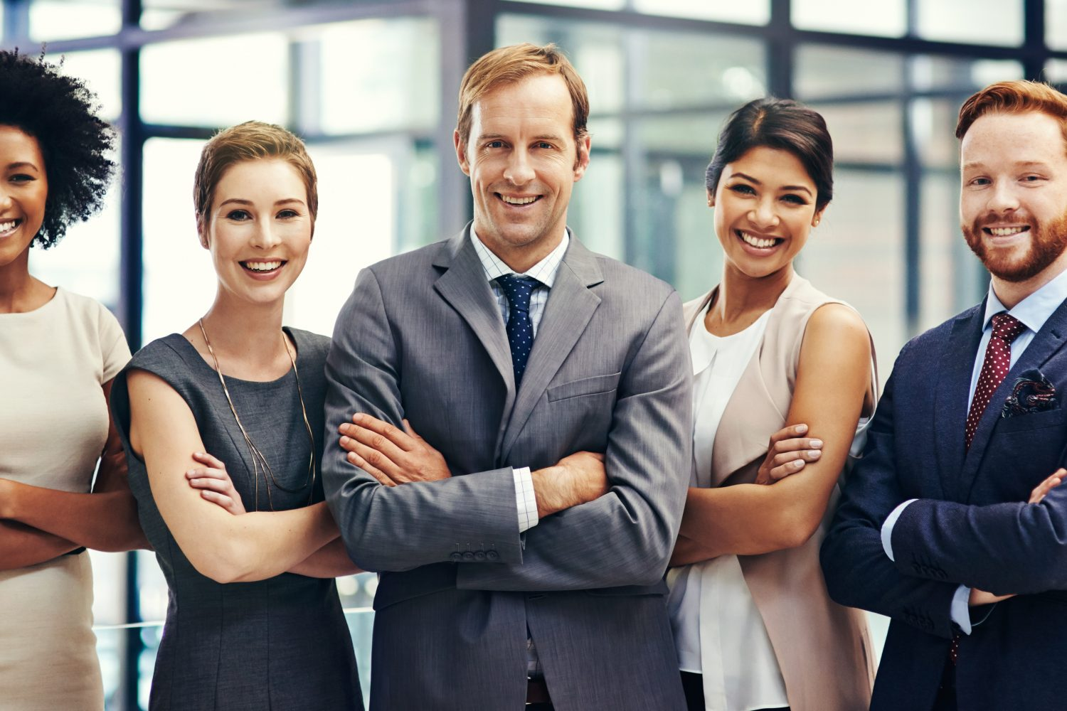 Portrait of a group of colleagues standing together in an office