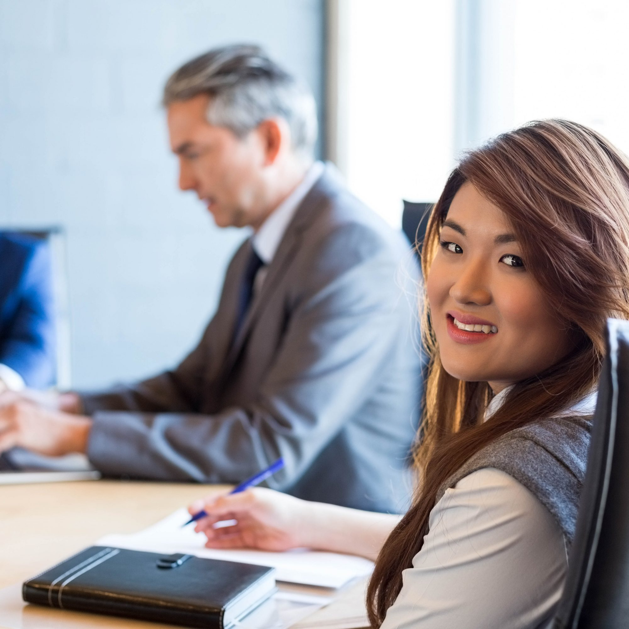 Confident businesswoman in a conference room during meeting at office